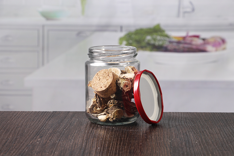 round glass jar with red metal lids
