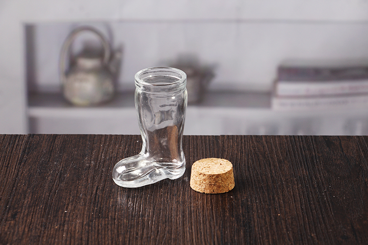 Boot shaped glass bottle