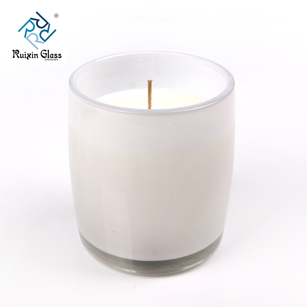 white glass candle jars